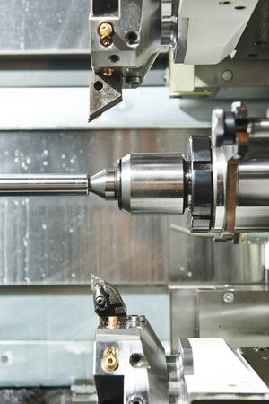 shaft detail turning on metal cutting machine tool at manufacturing factory Stock Photo