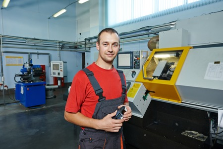 manufacture technician worker with micrometer at factory metal machining shop