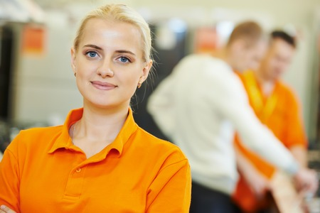 Positive sales assistant portrait in home appliance shop supermarket store photo