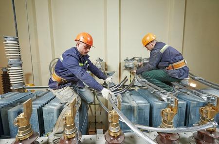 Industrial electrician lineman repairman workers team
