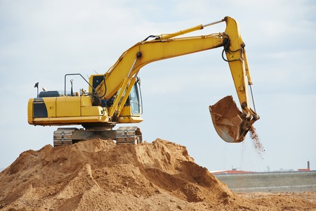 sand quarry: excavator machine at excavation earthmoving work in sand quarry Stock Photo