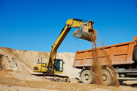 sand quarry: wheel loader excavator machine loading dumper truck at sand quarry