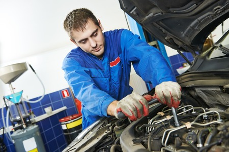 motor mechanic: auto repairman industry mechanic worker in car auto repair or maintenance shop service station