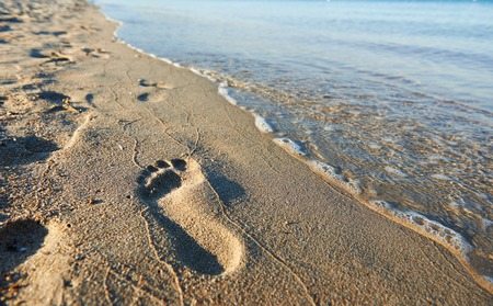 human footprint or footstep on sandy sea beach Stock Photo