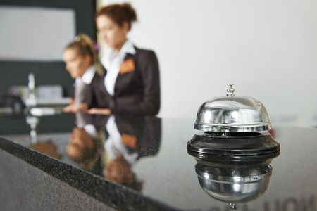 hotel worker: Modern luxury hotel reception counter desk with bell