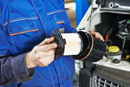 Car servicing, replacing of motor oil or fuel filter Stock Photo