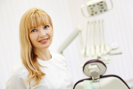 confident dentist orthodontist female doctor portrait at\ working place