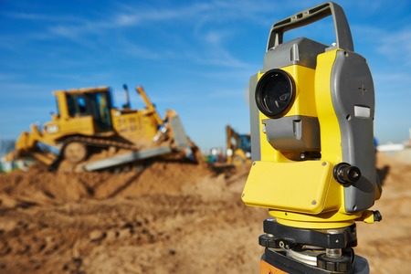 construction level: Surveyor equipment tacheometer or theodolite outdoors at construction site Stock Photo