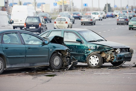 car on the road: car crash accident on street, damaged automobiles after collision in city Stock Photo