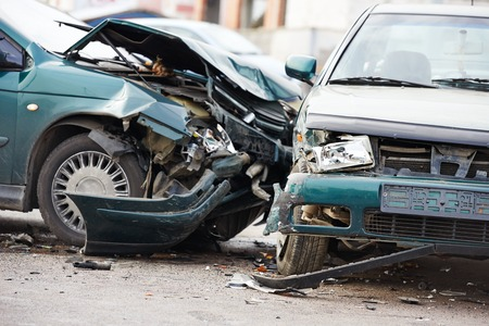 car crash accident on street, damaged automobiles after collision in city Archivio Fotografico