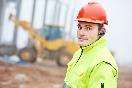 Adult construction manager or building site foreman worker photo