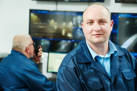 monitoring system: security executive chief in front of video monitoring surveillance security system