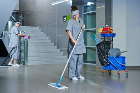 mopping: Floor care and cleaning services with washing machine in supermarket shop store