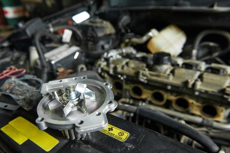 turbine engine: auto repair spare part turbine during automobile car maintenance at engine repair service station garage Stock Photo