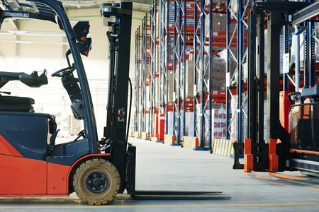 warehouse equipment: forklift loader pallet stacker truck equipment at warehouse