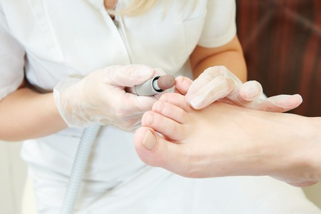 pedicure: Pedicure technique. Sole treatment during foot care in beauty salon