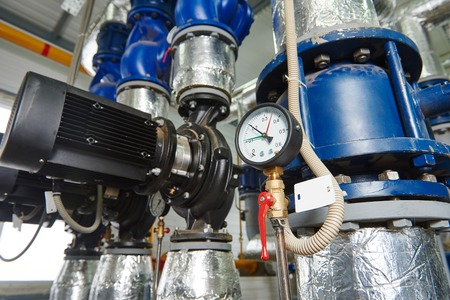 Closeup of manometer, pipes and faucet valves of gas heating system in a boiler room photo