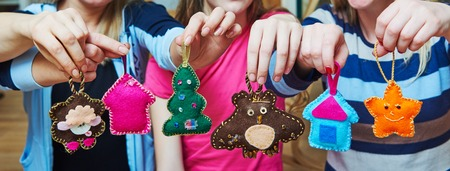 stitching: hand made soft toys from felt for Christmas tree decoration