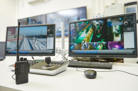 security room: video monitoring surveillance security system equipment with portable radio transmitter
