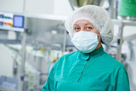 pharmaceutical factory woman worker at tablet production line in pharmacy industry manufacture factory photo