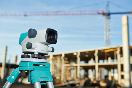 Surveyor equipment optical level outdoors at construction site photo