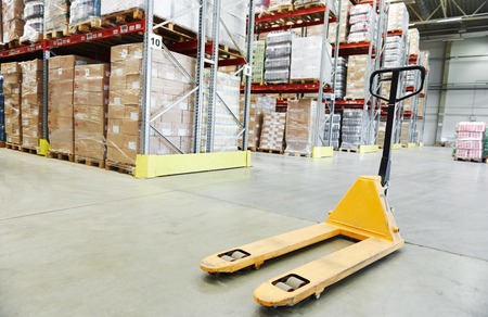 pallet truck: Manual forklift pallet stacker truck equipment at warehouse