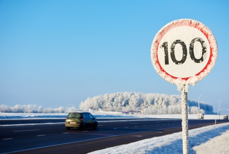 speed limit: Frozen speed limit sign at winter highway road