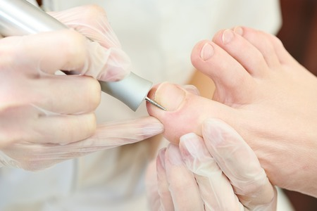 Pedicure nail procedure for foot care in beauty salon photo