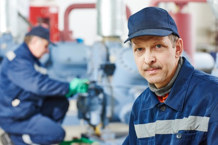 chiller: portrait of service engineer worker at industrial compressor station for refrigeration at manufacturing factory Stock Photo