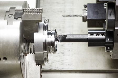 detail turning on metal cutting machine tool at manufacturing factory Stock Photo