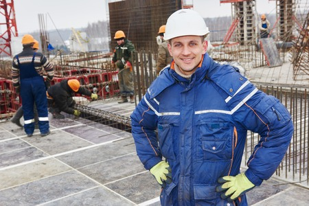 happy construction manager or building site foreman worker Stock Photo