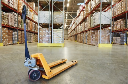 warehouses: Manual forklift pallet stacker truck equipment at warehouse
