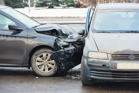 injuries: car crash accident on street, damaged automobiles after collision in city Stock Photo