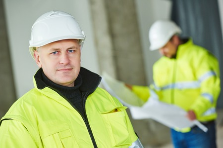 site manager: young male construction engeneer worker project manager at a indoors building site