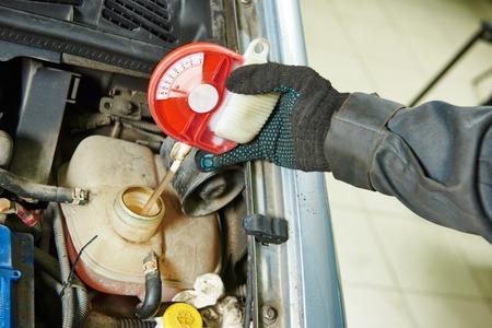 antifreeze: automobile mechanic tests car antifreeze liquid for winter and summer