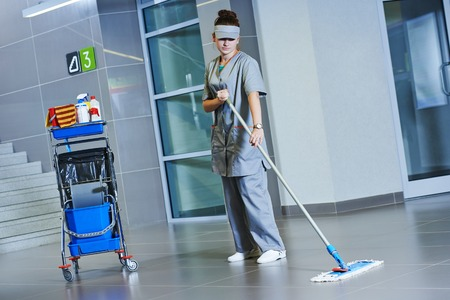 Floor care and cleaning services with washing machine in supermarket shop store photo