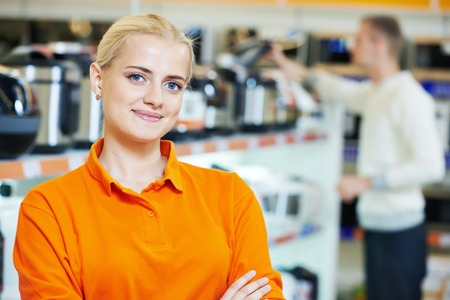 store clerk: Positive seller or shop assistant portrait  in supermarket store Stock Photo
