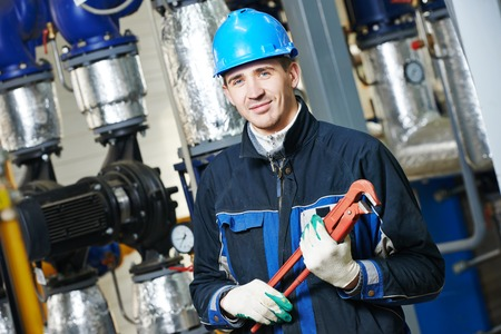 keeping room: industrial construction worker plumber  at boiler room Stock Photo
