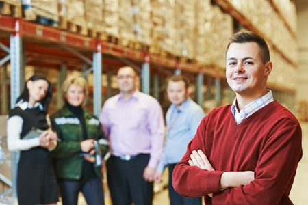 warehouse equipment: male manager and workers in warehouse