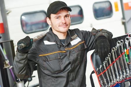 machinist: repairman auto mechanic portrait in car auto repair or maintenance shop service station