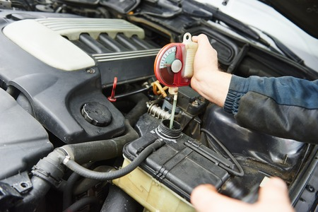 antifreeze: automobile mechanic tests car antifreeze liquid for winter and summer