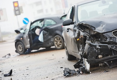 collision: car crash accident on street, damaged automobiles after collision in city Stock Photo