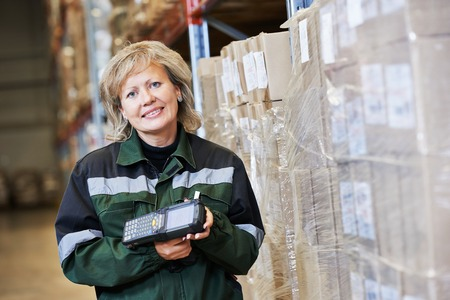 bar code scanner: female worker in warehouse working with bar code scanner