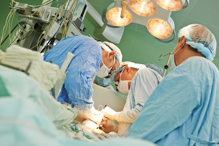 Team of surgeon in uniform perform operation on a patient at cardiac surgery clinic 스톡 콘텐츠
