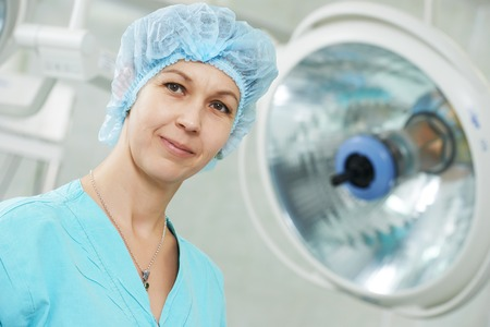 cardiosurgery: Portrait of surgeon nurse or doctor in uniform at cardiac surgery operation room