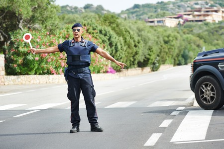 Italian special military police force carabinier stopping car photo