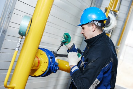 industrial heat engineer worker plumber at boiler room installation Stock Photo