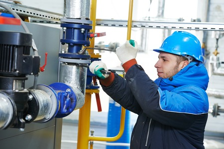 industrial heat engineer worker plumber at boiler room installation Zdjęcie Seryjne
