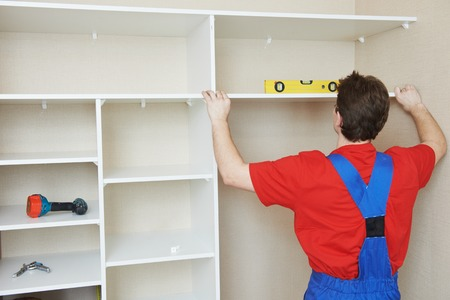 settle: carpenter worker joint and settle home built-in cupboard