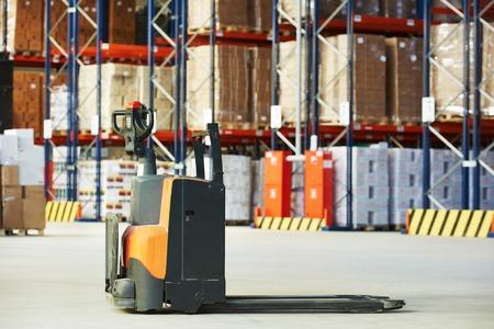 stacker: Manual forklift pallet stacker truck equipment at food warehouse